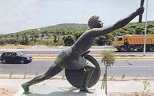 Athens Classic Marathon - A statue of Pheidippides on the route from Marathon to Athens