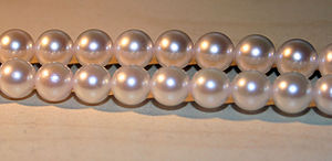 Strands of akoya cultured pearls from China. T...