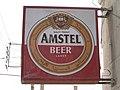 Street sign over liquor shop in Amman.jpg