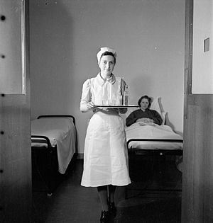 "Nurse uniform - This nurse's uniform consists of a ""spotless apron and a practical but attractive mob cap, made simply from a plain triangle of linen"". 1943."