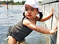 Swimsuit toddler girl in white hat.jpg