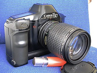 Canon T90 - Front view; it is a large camera. The battery tray forms a modest portrait grip.