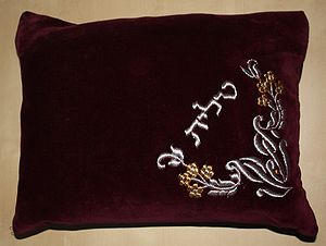 Tallit - A typical tallit bag. The Hebrew embroidery says tallit. Frequently the owner will add additional embroidery with their name.