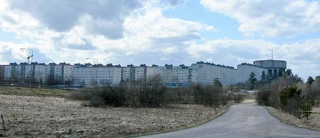 Modern Tensta, with its concrete apartment buildings of Plattenbau style, was (like nearby Rinkeby and Hjulsta) part of the so-called Million Programme. Tenstabetong.jpg