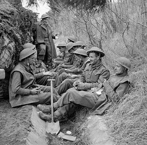 3rd Infantry Brigade (United Kingdom) - Men of the 1st Battalion, King's Shropshire Light Infantry eat a meal before going into action at Anzio, Italy, 31 January 1944.