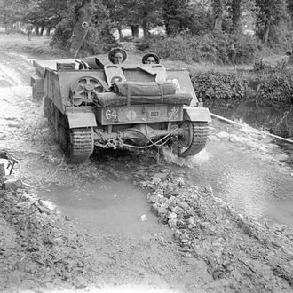 43rd (Wessex) Infantry Division - A Loyd carrier of the 8th Battalion, Middlesex Regiment advances during operations in the Odon valley, west of Caen, 16 July 1944.