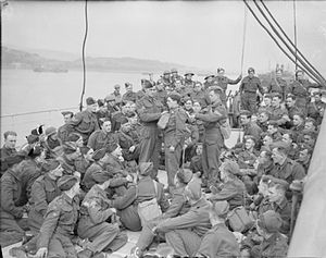 49th (West Riding) Infantry Division - Some members of the 1/6th Battalion, Duke of Wellington's Regiment testing gas equipment on board the Polish liner MS Sobieski, April 1940. She is lying off Gourock, Scotland and has been used as a troopship for some months. The men will soon be heading off to Norway.