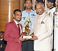 The President, Shri Ram Nath Kovind presenting the Arjuna Award, 2018 to Shri Manoj Sarkar for Para-Badminton, in a glittering ceremony, at Rashtrapati Bhavan, in New Delhi on September 25, 2018.JPG
