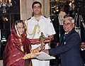 The President, Smt. Pratibha Devisingh Patil presenting the Dronacharya Award for the year-2011 to Dr. Kuntal Roy for Athletics, in a glittering ceremony, at Rashtrapati Bhavan, in New Delhi on August 29, 2011.jpg