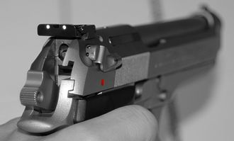 Dovetail rail - A Beretta 92FS pistol with a dovetail mounted rear sight.