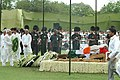 The Union Minister for Railways, Shri Lalu Prasad laying wreath at the mortal remains of the former Prime Minister, Shri Chandra Shekhar at the funeral pyre, in Delhi on July 09, 2007.jpg