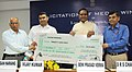 The Union Steel Minister, Shri Beni Prasad Verma presenting the cheque of Rs. 20 Lakh to Shri Gagan Narang, the London Olympic Bronze Medal winner in Shooting, at a felicitation function, in New Delhi on August 16, 2012.jpg