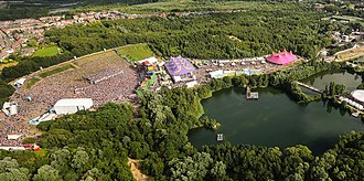 An aerial photograph of part of the Tomorrowland site, including the main stage to the left, 2014 TomorrowLand - A Look From The Sky (13891384681).jpg