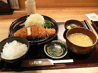 Breaded cutlet - Tonkatsu served with shredded cabbage, boiled rice and miso soup in Sapporo, Hokkaido, Japan