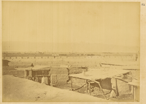 Town of Gucheng, Devastated during the Riots. Visible in the Background is a Ridge of Tian Shan (Tian Mountain) with Bogda Peak. Xinjiang, China, 1875 WDL2061.png