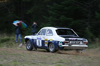 Travis Pastrana - Pastrana driving a classic Ford Escort Mk1 at the 2008 Colin McRae Forest Stages.