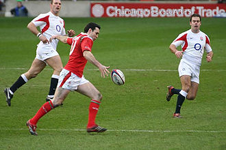 Rugby union gameplay - Ex-Wales Fly Half, Stephen Jones, about to punt the rugby ball