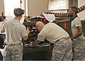 U.S. Air Force Senior Airmen Alfred Fyvie, Joshua Ruberg and Mister Braxton, all with the 361st Training Squadron, check a wiring diagram to troubleshoot an electrical problem June 8, 2011, at Sheppard Air Force 110608-F-NS900-027.jpg