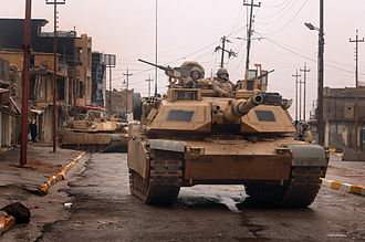 Transparent Armor Gun Shield - TAGS installed on the loader's M240 machine gun on top of M1A2 Abrams tank. (U.S. Army patrol in the city of Tall Afar, Iraq, on February 3, 2005.)