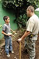 U.S. Army Spc. Jesus Salamanca, assigned to the 160th Engineer Company, New Hampshire Army National Guard, receives a briefing from a Boy Scout with Troop 967, based in San Salvador, El Salvador, about 130601-A-OM689-004.jpg