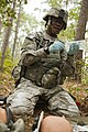 U.S. Army Spc. Shaniqua King, an Expert Field Medical Badge (EFMB) candidate with the 257th Dental Company (Area Support), prepares a bag of fluid during the EFMB competition at Fort Bragg, N.C., Oct. 29, 2013 131102-A-KS175-013.jpg