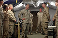 U.S. Navy Master Chief Petty Officer Christopher Aldis, center, the command master chief of the 2nd Marine Aircraft Wing, congratulates Seaman Kyle Peterson, second from right, a casualty evacuation corpsman 100305-M-QQ833-022.jpg