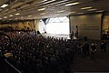 U.S. Navy Rear Adm. Frank L. Ponds, at lectern, the commander of Expeditionary Strike Group 3, gives closing remarks as part of a 9-11 remembrance ceremony in the hangar bay of the newly commissioned amphibious 140911-N-LQ799-155.jpg