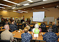 U.S. Sailors listen as Kathleen Schofield, Sexual Assault Response Coordinator Navy Region Northwest, says a few words during the Sexual Assault Prevention and Response advocate appreciation reception event held 110427-N-ZK021-001.jpg