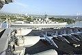 U.S. Sailors render honors aboard the aircraft carrier USS Nimitz (CVN 68) as the ship passes the Battleship Missouri Memorial while arriving at Joint Base Pearl Harbor-Hickam, Hawaii, Dec. 3, 2013 131203-N-AZ866-082.jpg
