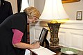 U.S. Sen. Claire McCaskill, the Evening Parade guest of honor, signs a guest book at Marine Barracks Washington 130517-M-MI461-025.jpg