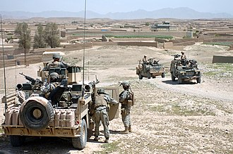 Helmand province campaign - American and British soldiers patrolling through a town in Helmand Province, 2007