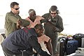 USCG evacuates injured Haitian woman onto HC-130 2010-01-14.jpg