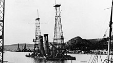 Photograph showing both ships partially underwater, the cage mast stick out of the water