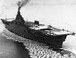 USS Lexington (CV-16) steams through floating ice in Boston Harbor, Massachusetts (USA), on 17 February 1943 (80-G-35657).jpg