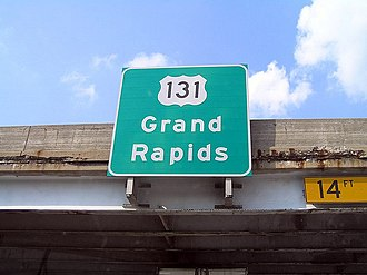 U.S. Route 131 - Guide sign mounted to a freeway overpass