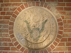 A defaced Great Seal of the United States at the former U.S. embassy, Tehran, Iran, as it appears today