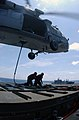 US Navy 030427-N-5781F-006 An SH-60 Seahawk hovers above flight deck aboard USS Kitty Hawk (CV 63), offloading ammunition to the ammunition ship USNS Flint (T-AE 32) during a vertical replenishment.jpg