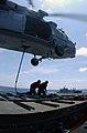 US Navy 030427-N-5781F-006 An SH-60 Seahawk hovers above flight deck aboard USS Kitty Hawk (CV 63), offloading ammunition to the ammunition ship USNS Flint (T-AE 32) during a vertical replenishment.jpg