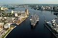 US Navy 030820-N-9851B-017 Tug boats guide USS Harry S. Truman (CVN 75) up the Elizabeth River, past Portsmouth landmarks, to the Norfolk Naval Shipyard.jpg