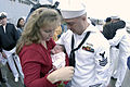 US Navy 030919-N-6477M-141 Gas Turbine System Mechanic 1st Class Eric McCartney assigned to USS Ingraham (FFG 61) meets his new five day old daughter upon returning from deployment.jpg
