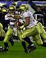 US Navy 031206-N-9693M-028 Navy quarterback Craig Candeto hands off to fullback Kyle Eckel during the 104th playing of the Army Navy game at Lincoln Financial Field, Philadelphia, Pa.jpg