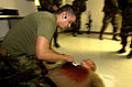 US Navy 031212-N-9964S-019 Hospital Corpsman 3rd Class John Williams, treats Pfc. Glenn Vanhoesen, for a simulated sucking chest wound during a mass casualty training exercise.jpg