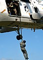 US Navy 040408-N-8921O-012 Aircrew Survival Equipmentman 2nd Class John Mann, of San Diego, Calif., fast ropes out of a UH-3H Sea King helicopter.jpg