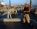 US Navy 040613-N-0401E-004 Engineman 2nd Class Robert Looney stands watch on the North end of Al Basrah Oil Terminal (ABOT).jpg