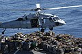 US Navy 050618-N-0167B-129 A Sailor assigned to the Military Sealift Command (MSC) combat stores ship USNS Niagara Falls (T-AFS 3), runs across the flight deck after attaching a cargo pallet to an MH-60S Seahawk.jpg