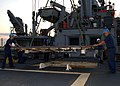 US Navy 050906-N-0535P-084 U.S. Navy Sailors aboard the rescue and salvage ship USS Grapple (ARS 53), remove a large deck hatch while preparing for salvage operations in the aftermath of Hurricane Katrina.jpg