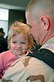 US Navy 070212-N-4014G-161 Equipment Operator 1st Class Brian Oelke, assigned to Cargo Transfer Platoon One (CTP-1), holds his daughter after returning from deployment.jpg