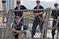 US Navy 070304-N-4965F-014 Sailors aboard guided missile destroyer USS Howard (DDG 83) heave around on a line while mooring pierside Naval Station Pearl Harbor.jpg