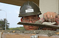 US Navy 070419-N-4198C-062 Engineering Aid 3rd Class Jon Anderson, a Seabee attached to Naval Mobile Construction Battalion (NMCB) 3, uses a magnesium float during the construction of a wall at Camp Shields.jpg