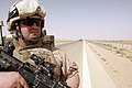 US Navy 070611-M-3717S-025 Lance Cpl. Robert Wayne Rapp, a native of Bourbonnais, Ill., performs a dismounted patrol around his seven-ton truck while at a security halt.jpg